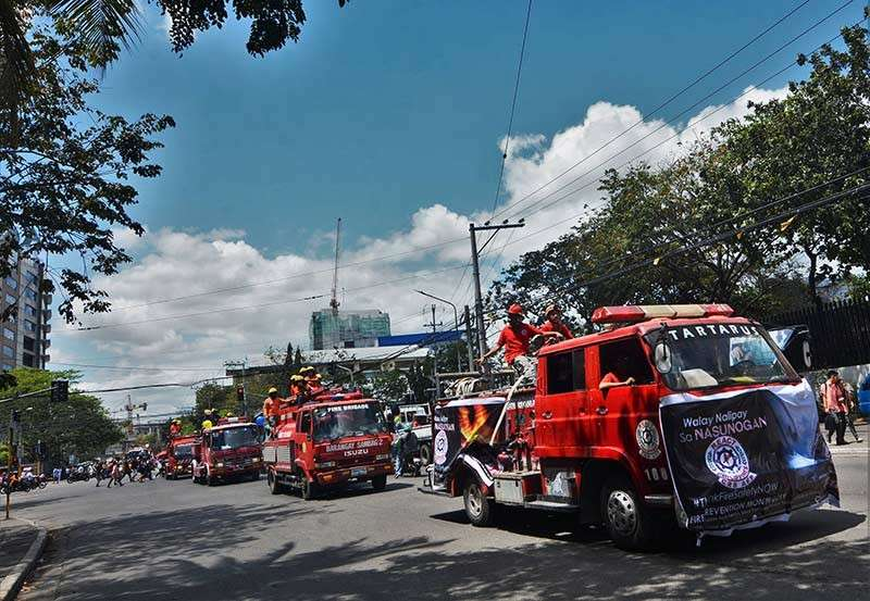 Parade of firetrucks. Firetrucks from different stations were paraded around the city  for the first day of the Fire Prevention Month. (SunStar Photo/Amper Campaña)