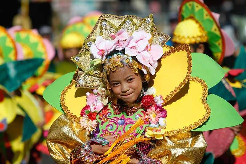 BAGUIO. Street dancers from the elementary, high school and open division kick off the two-day parades as celebration of the annual Baguio flower Festival gets going Saturday and Sunday with 17 competing in street dancing and 24 joining the float parade. (Photo by Jean Nicole Cortes)
