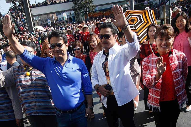 Senatorial candidates Bong Revilla, Lito Lapid, and Ilocos Governor Imee Marcos join thousands during the grand street parade on March 2 in celebration of the Panagbenga Festival. (Photo by Jean Nicole Cortes)