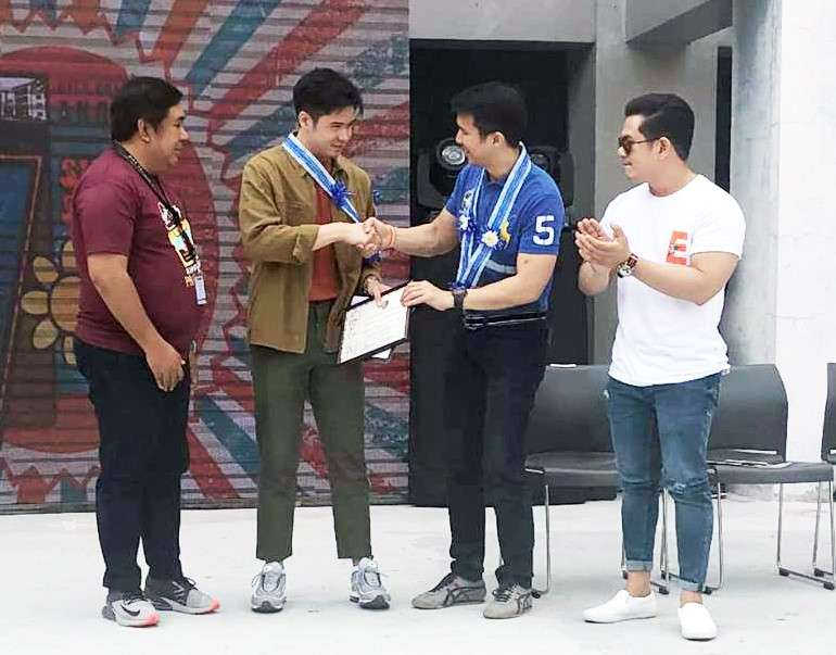 Vice Mayor Bryan Nepomuceno, Councilor Edu Pamintuan, and City College of Angeles (CCA) president Richard Daenos award a student of CCA during the school's seventh founding anniversary last February 26. During the event, Nepomuceno said they will spend P1 billion for the city's public tertiary school. (Contributed Photo)