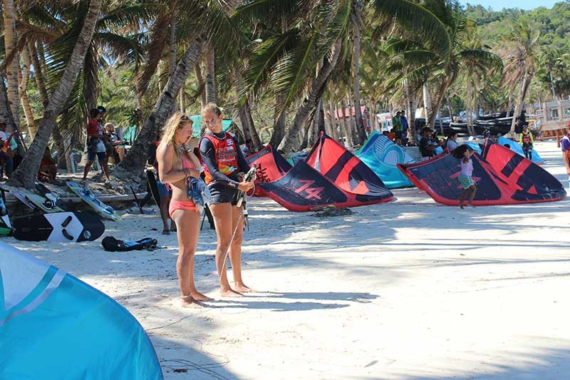 AKLAN. Two female kitesurfers chat with each other at the Bulabog beach during the international kiteboarding tournament in Boracay. (Jun N. Aguirre)