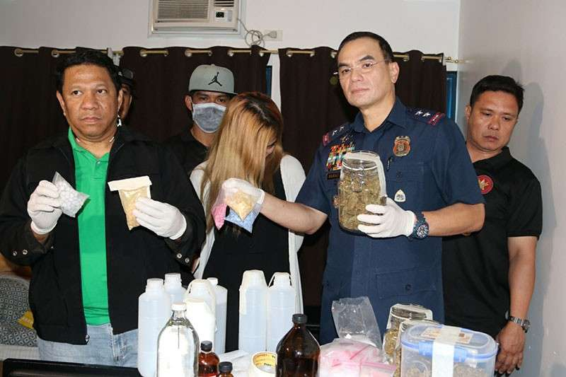 MANILA. National Capital Region Police Office Chief Guillermo Eleazar (right) presents the female suspect who allegedly yielded P14 million worth of party drugs. (Photo courtesy of NCRPO)