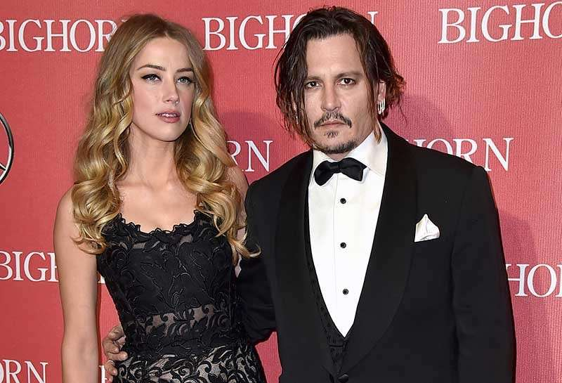 Amber Heard and Johnny Depp in happier times. (AP)