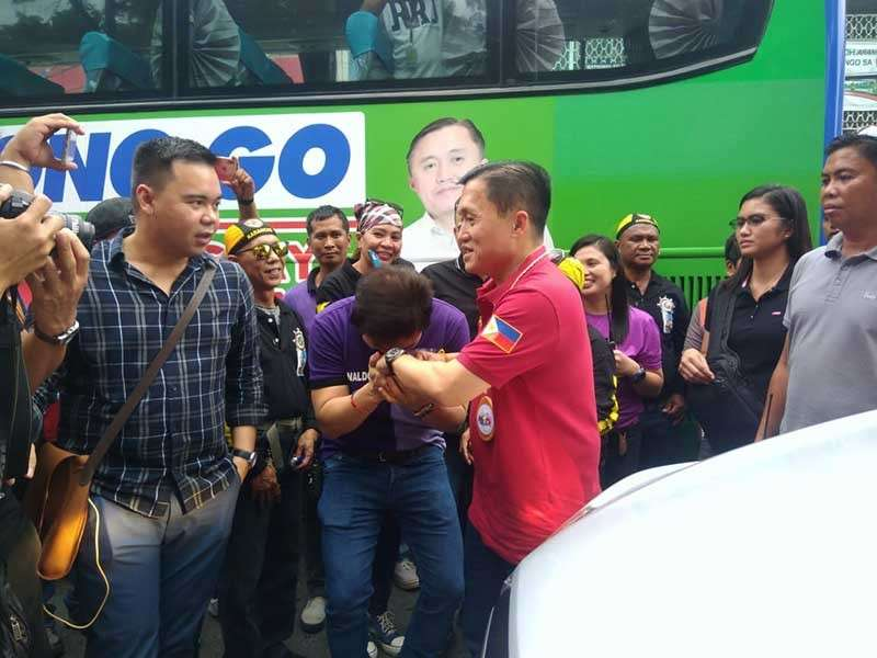 "CAGAYAN DE ORO. Misamis Oriental congressional aspirant Benjo Benaldo (center) bows toward the hand of Christopher Lawrence ""Bong"" Go, who is running for senator, in a traditional gesture of doing a ""mano po,"" during the latter's visit in Cagayan de Oro City on Saturday, March 2. (Alwen Saliring)"