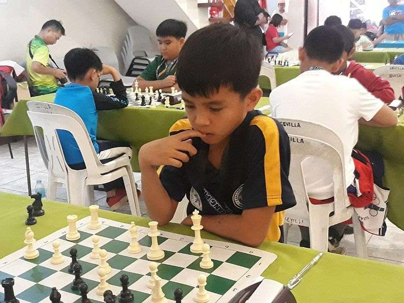 DAVAO. James Catayas of Buhangin, Davao City, studies his next move in a match during the just-concluded 2019 National Age-Group Chess Championships Mindanao Leg held in Municipality of M'lang in North Cotabato. He eventually clinched the boys under 12 title. (Photo by James Infiesto)