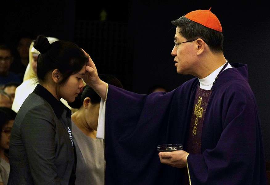 PAMPANGA. Cardinal Luis Antonio Tagle places ashes on the head of a woman during the Ash Wednesday Mass at the Manila Archdiocese Chapel in Intramuros, Manila. (CBCP file photo)