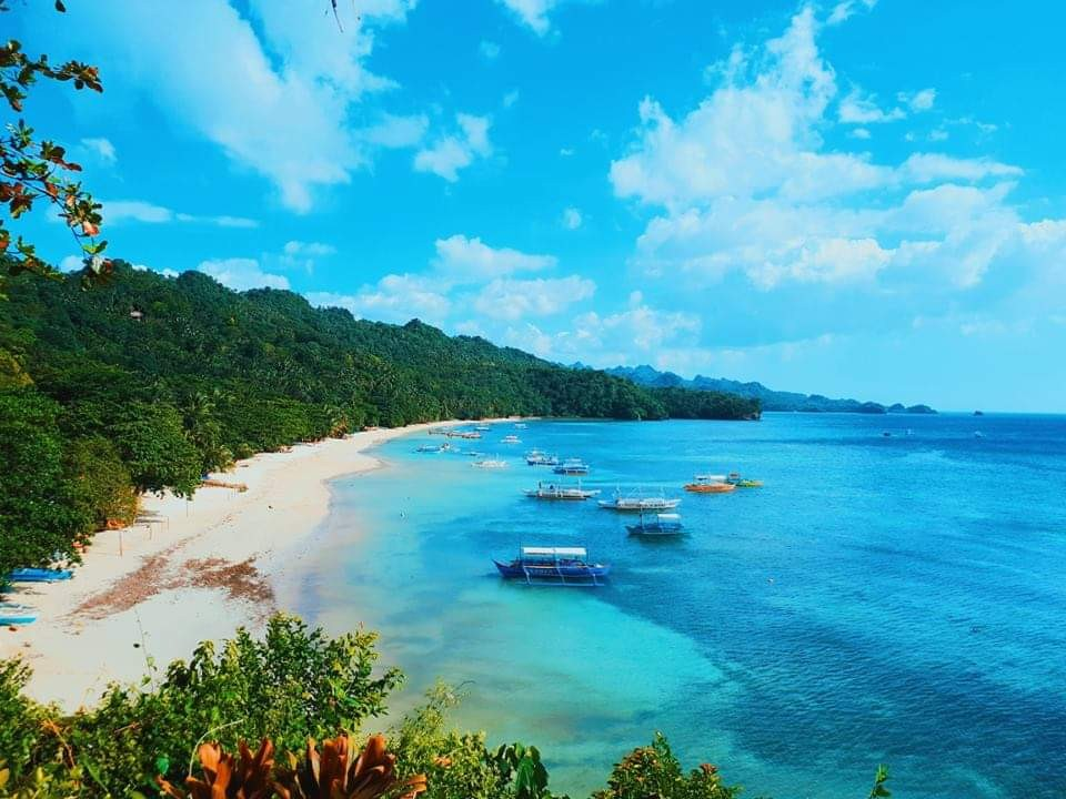 This kilometer-stretch of white sand beach at Barangay 4 in Sipalay City is one of the nature-based tourism offerings of Negros Occidental attracting local and foreign tourists. (Jerick Lacson Photo)