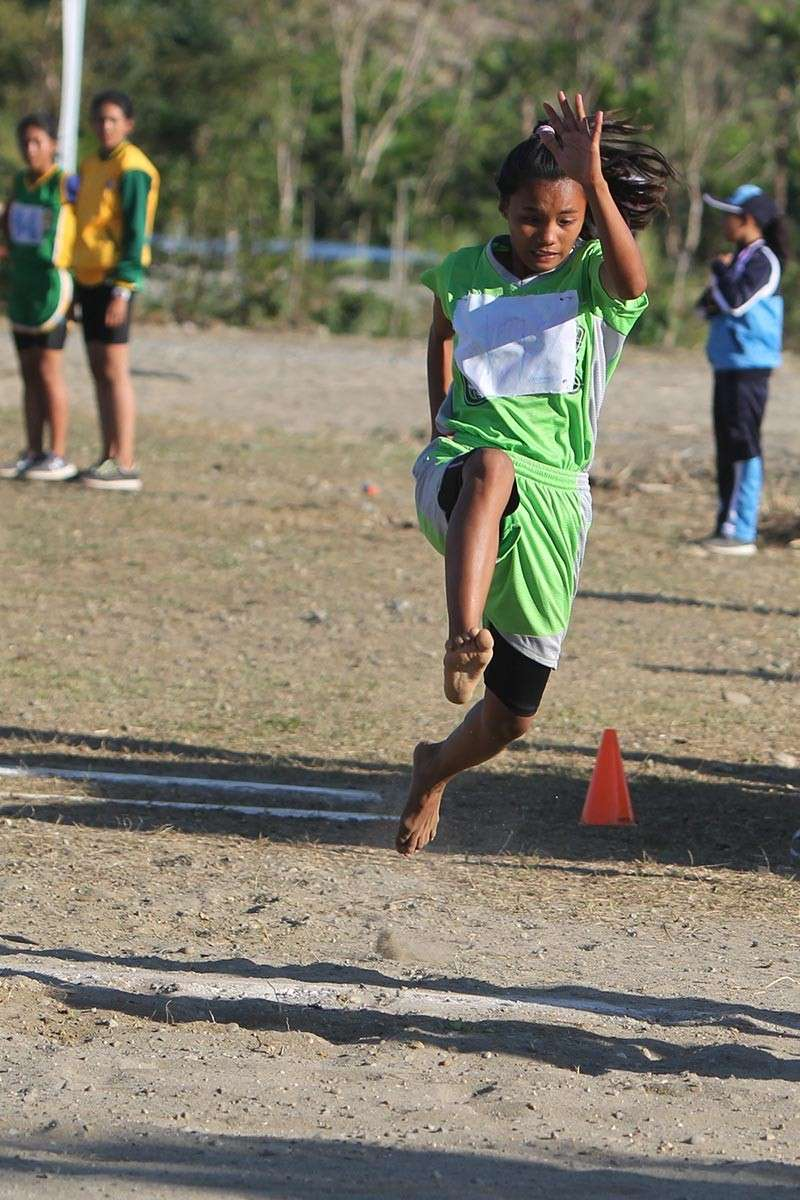 APAYAO. Tabuk City's Bablyn Purisima leaps her way to gold medal after jumping to 8.81 meters during the triple jump event in the elementary girls division of the Cordillera Administrative Region Athletic Association (Caraa) sports meet last week in Apayao. (Photo by Roderick Osis)