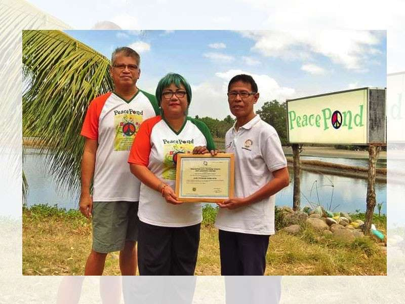 NEGROS. (From left) PeacePond founders Antonio Jesus and Checcs Orbida receive the certificate of accreditation as agri-tourism site from Department of Tourism- Western Visayas Regional Administrative Officer Artemio Ticar at the farm in Barangay Enclaro in Binalbagan town on Wednesday, March 6. (Contributed photo)