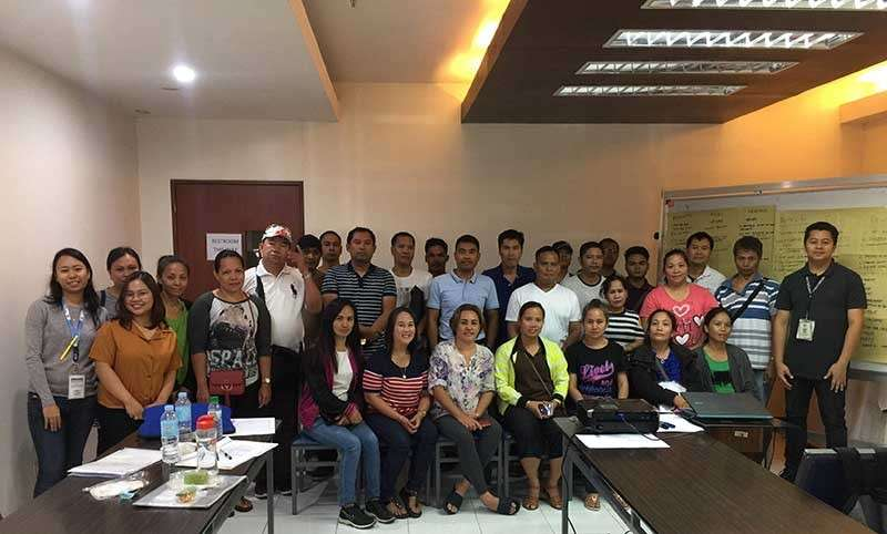 BACOLOD. Business counselor Gab Advincula (right) with the 28 participating Negrense Overseas Filipino Workers during the entrepreneurship and business planning seminar held at the Negros First Negosyo Center in Bacolod City. (Contributed photo)