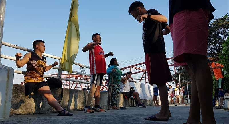 CAGAYAN DE ORO. Some persons with disabilities warm up with their teammates Saturday morning, March 9, at Duaw Park, Cagayan de Oro. Their group is preparing for a Mindanao-wide dragon boat race in Cortes, Surigao del Sur from March 16-18. (Nef Luczon)