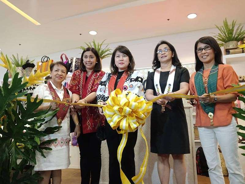 DAVAO. Officials from DTI-Davao region, DOT-Davao region, and MTEFI during the ribbon-cutting ceremony to officially open the store (Photo by Lyka Amethyst H. Casamayor)