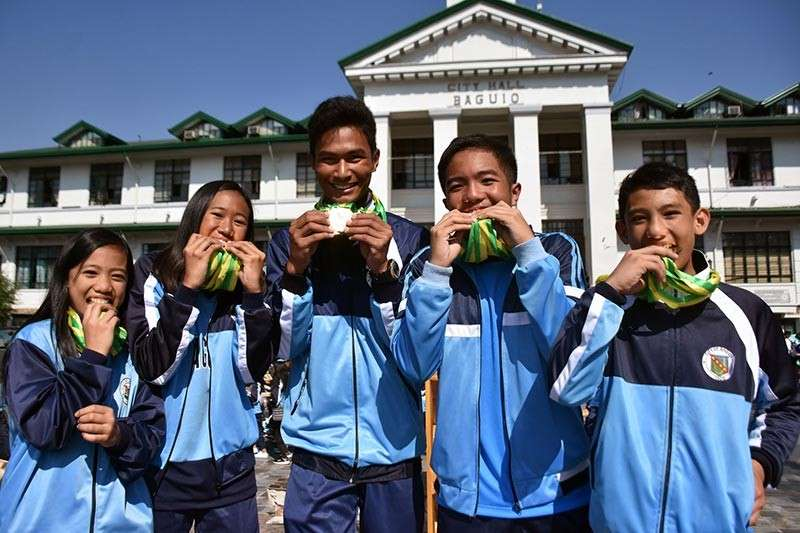 BAGUIO. The most bemedalled athletes during the Cordillera Administrative Region Athletic Association (Caraa) meet 2019 namely (L-R) Hannah Jean Walang of Elpidio Quirino Elementary School who garnered seven golds in arnis, Juleana Conlu of Saint Louis University – Laboratory Elementary School who took home 7 golds in swimming, Reuben Supeña of Baguio City High School who also got 7 golds in archery, Maenard Rhoman Batnag of BCHS who got seven golds in swimming and Justin Apilas of EQES who got 6 golds and 1 silver in arnis. (Photo by Redjie Melvic Cawis)