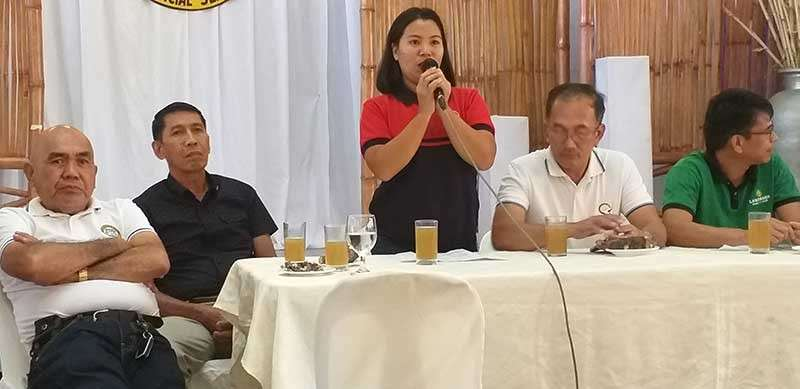 BACOLOD. Production Loan Easy Access program focal person in Negros Occidental Jane Aplaon (center) speaks at the Commodity Investment Forum at the Provincial Capitol in Bacolod City. (Erwin p. Nicavera)
