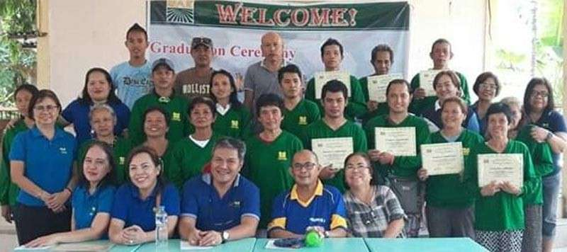 CARING FOR CARMEN FARMERS. Government officials pose with the farmers, who were trained in organic farming technology. (Contributed photo)