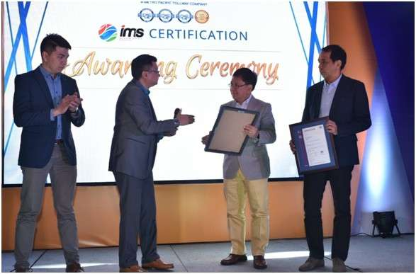 PAMPANGA. DQS Certification Philippines Inc. managing director Romeo Zamora hands the ISO 9001:2015 certificate to NLEx Corporation president and general manager Luigi Bautista. Also with them are DQS Certification Philippines Inc. business development specialist Urich Lucio and NLEx Corporation COO Raul Ignacio. (Contributed Photo)
