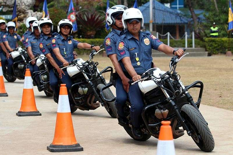 BAGUIO. Cordillera police demonstrate proper form while riding in tandem through the slalom course at the PRO-COR grandstand on Tuesday. Some 64 cops and 23 civilian riders completed the Motorcycle Riding Course (MRC) and Motorcycle Riding Safety Training (MRST). (Photo by Jean Nicole Cortes)