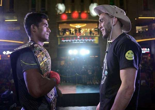 BAGUIO. Reigning Brave Combat Federation bantamweight champion Stephen Loman face off with challenger and former Brave featherweight champ Elias Boudegzdame during a public workout on March 13 at the luxurious World Resort Manila. (Brave CF photo)