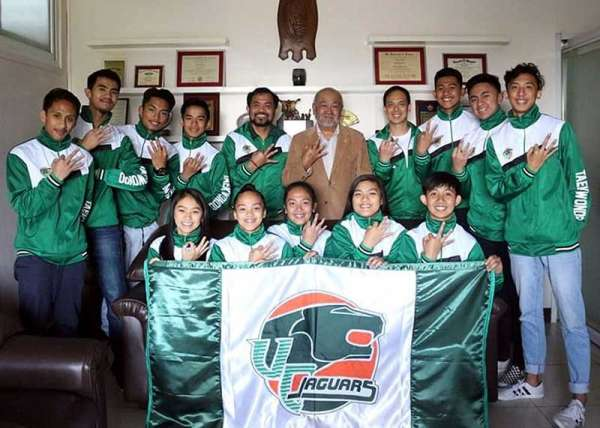 BAGUIO. University of the Cordilleras judo team joins UC president Ray Dean Salvosa (standing fifth from right) and athletic director Danilo Cong-o (standing fifth from left) flashing the number three sign after lording the BBEAL taekwondo competition recently. (UC photo)
