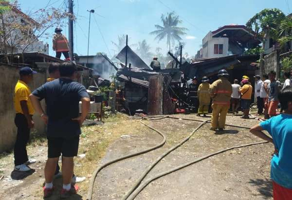 CEBU. Three houses, one was destroyed while two others were damaged, when a late morning blaze hit Sitio Upper Lusimba, Barangay Pardo in Cebu City on Saturday, March 16. (Contributed photo/ Francis Espares)