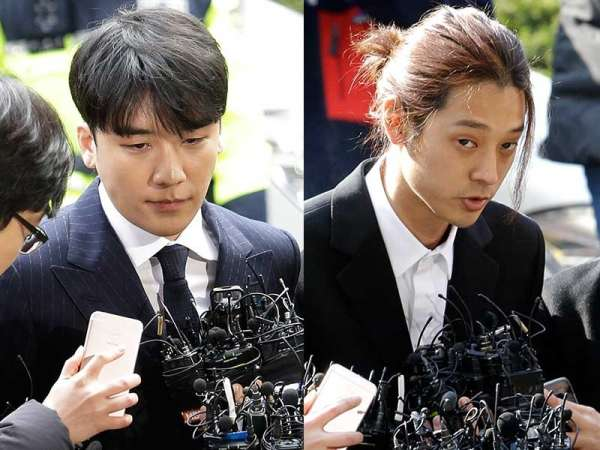 Seungri, left, member of a popular boy band Big Bang, and singer Jung Joon-young arrive at the Seoul Metropolitan Police Agency in Seoul, South Korea, Thursday, March 14, 2019. After their stunning retirement announcements, two K-pop stars are facing police questioning over a series of interlocking scandals that have roiled South Korea for weeks. (AP)