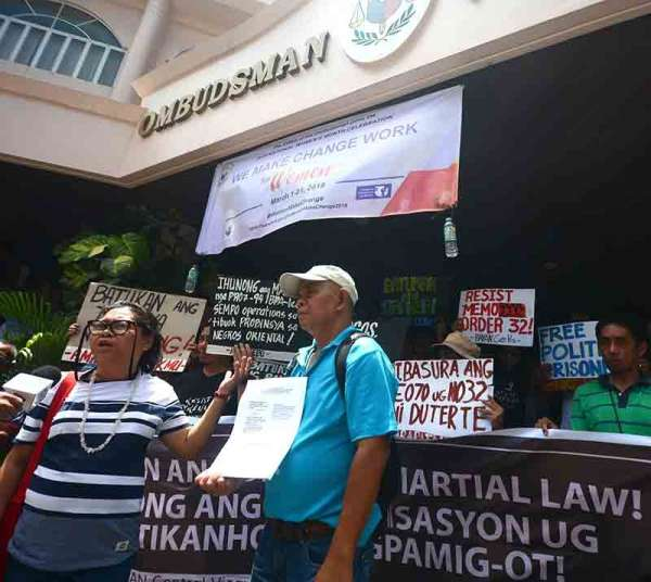 """SERIOUS MISCONDUCT.  Members of cause-oriented groups accuse the police general  of serious misconduct for allowing police to play """"Voltes V"""" while they were having a rally  to commemorate the Edsa revolution anniversary last month.  (SunStar Photo / Amper Campaña)"""