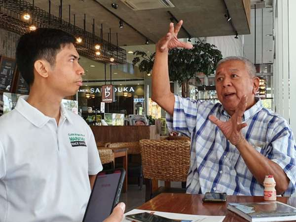 """PAMPANGA. Talaingat Danum chairman Renato """"Abong"""" S. Tayag, Jr. (right) and president Louie Reyes discuss ways to re-use and save water as they fear that a water shortage will also be felt in Angeles City and some parts of the province if conservation measures are not taken immediately. (Photo by Chris Navarro)"""
