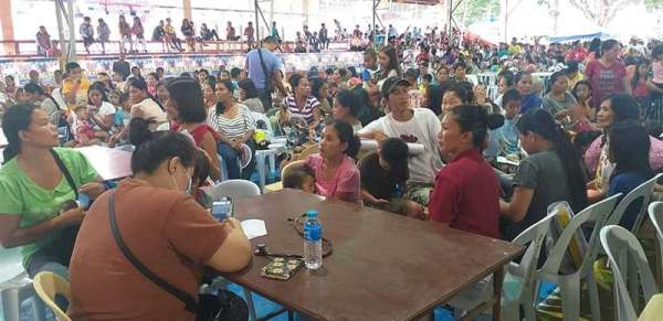 NEGROS. Hundreds of residents avail themselves of the services of the medical mission held at the auditorium of Isabela town. (Contributed photo)