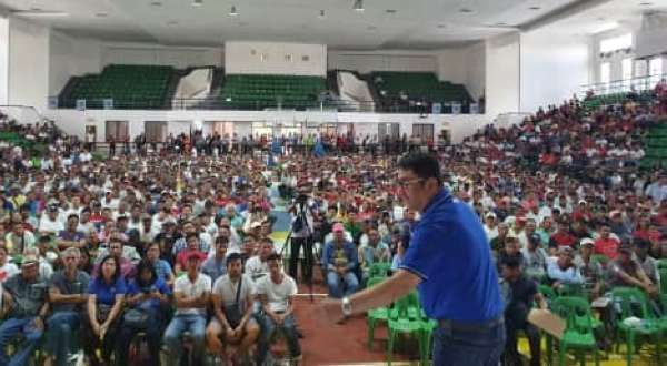 "PAMPANGA. Third District Congressman Aurelio ""Dong"" Gonzales, Jr. discusses his assistance program for farmers during Monday's rehabilitation and recovery program for affected farmers by typhoons and habagat initiated by the Provincial Government of Pampanga in cooperation with the solon's office. (Chris Navarro)"