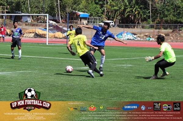 DAVAO. Two players struggle for possession during the UP Mindanao Mens Football Cup Round 1 9-A-Side Football Cup held at the Davao City-UP Sports Complex Stadium over the weekend. (UP Mindanao Photo)