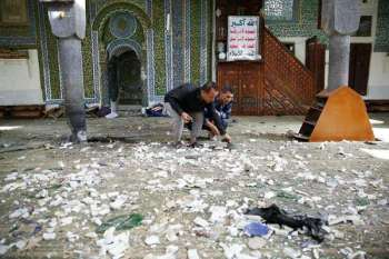 YEMEN. In this September 24, 2015, file photo, police inspect inside the al-Balili mosque after suicide bombings at the mosque during Eid al-Adha prayers in Sanaa, Yemen. (AP)
