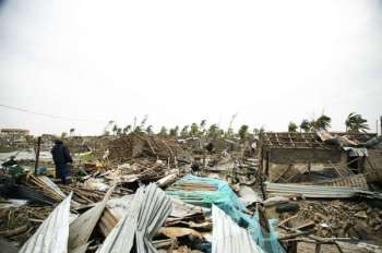 MOZAMBIQUE. In this photo taken on Friday, March 15, 2019 and provided by the International Red Cross, a man searches through the rubble after Tropical Cyclone Idai, in Beira, Mozambique. Mozambique's President Filipe Nyusi says that more than 1,000 may have by killed by Cyclone Idai, which many say is the worst in more than 20 years. Speaking to state Radio Mozambique, Nyusi said Monday, March 18 that although the official death count is currently 84, he believes the toll will be more than 1,000. (AP)