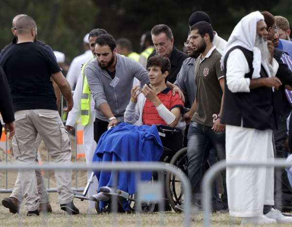 NEW ZEALAND. Zaed Mustafa, in wheelchair, brother of Hamza and son of Khalid Mustafa killed in the Friday, March 15, mosque shootings reacts during the burial at the Memorial Park Cemetery in Christchurch, New Zealand, Wednesday, March 20. (AP)