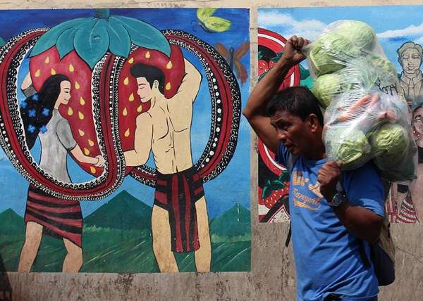 BENGUET. Mural paintings greet visitors along Km. 5 in La Trinidad, Benguet. The local government initiated a mural painting competition in celebration of the 38th Strawberry Festival. (Photo by Jean Nicole Cortes)