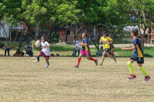 DAVAO. A San Roque Central Elementary School player controls the ball against Buhisan Elementary School rivals during their game in the 82nd Araw ng Dabaw Get Into Rugby Festival at Tionko field recently. (Contributed Photo By Gary Sato)