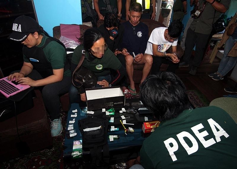 BAGUIO. Anti-narcotics agents from the Philippine Drug Enforcement Agency (PDEA) conduct an inventory of the drug paraphernalia confiscated after the implementation of a search warrant in Upper QM, Baguio City.  (Photo by Jean Nicole Cortes)