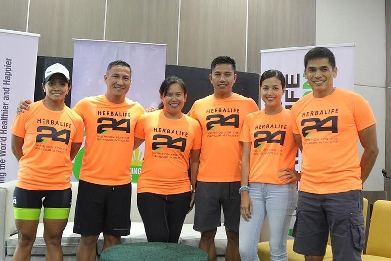 DAVAO. Herbalife Philippines brand ambassadors from left, Dwan Abantao, Omar Paredes, Laarni Paredes, Ronald Mokit, Ines Santiago and Julian Valencia along with three others will compete in the second Alveo Ironman 70.3 set Sunday in an out-and-back course from Azuela Cove, Lanang, Davao City. (Mark Perandos)