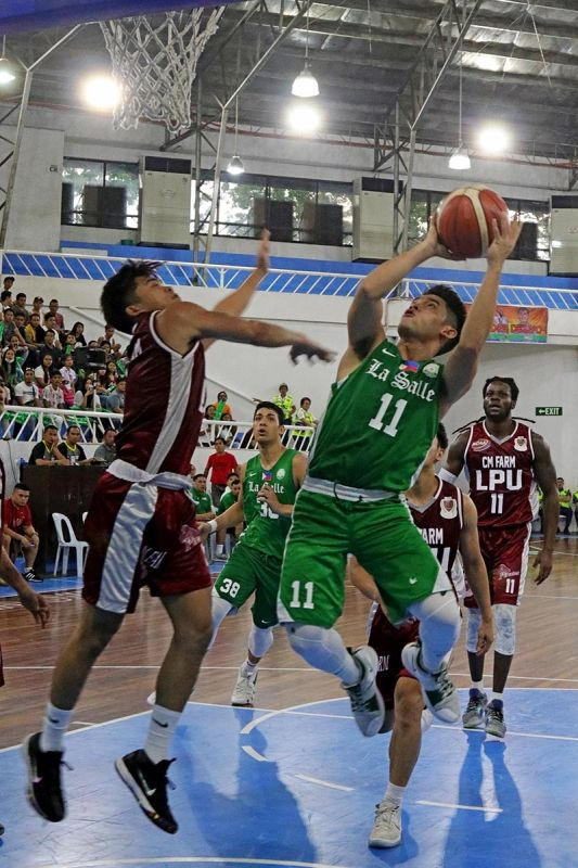 DAVAO. De La Salle University (DLSU) Green Archer Aljun Melecio, right, shoots against a Lyceum of the Philippines University (LPU) defender during their elimination round game of the 82nd Araw ng Dabaw college invitational basketball tournament Wednesday evening at the Almendras Gym Davao City Recreation Center. (Mark Perandos)