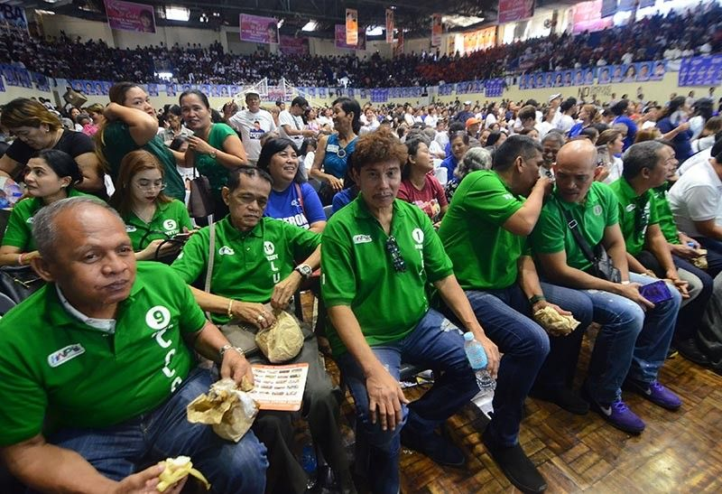 CEBU. San Fernando, Cebu mayoral candidate Ruben Feliciano (third from right) with other local candidates attends the Hugpong ng Pagbabago caravan rally at the Mandaue City Cultural and Sports Complex, Thursday, March 21. (SunStar/Alan Tangcawan)
