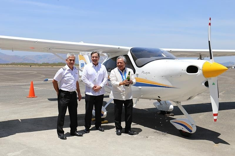 AVIATION ACADEMY. First Aviation Academy officials pour champagne on a brand-new Tecnam P2010 plane during the launch of the First Aviation Academy in the Subic Bay Freeport on Thursday, March 21, 2019. (Photo by Ric Sapnu)