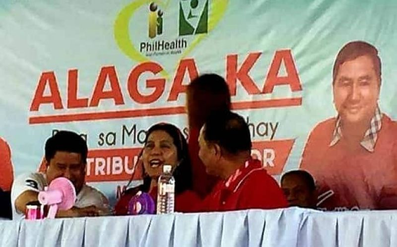 "PAMPANGA. Fourth District Congressman Juan Pablo ""Rimpy"" P. Bondoc shakes hands with San Simon Mayor Leonora C. Wong and comebacking Rodrigo ""Digos"" Canlas during the PhilHealth Alaga Ka program on Thursday, March 21, ending years of ""word wars"" between them. (Photo by Chris Navarro)"