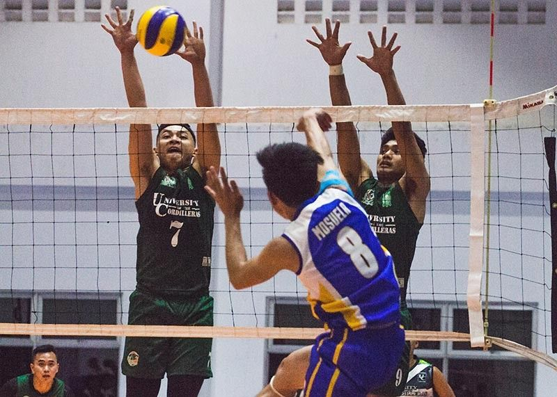 BAGUIO. University of the Cordilleras Jaguars crush the Saint louis University Navigators to secure top spot in bracket B of the ongoing Baguio-Benguet Educational Athletic League (BBEAL) men's volleyball tournament. (Photo by Jean Nicole Cortes)
