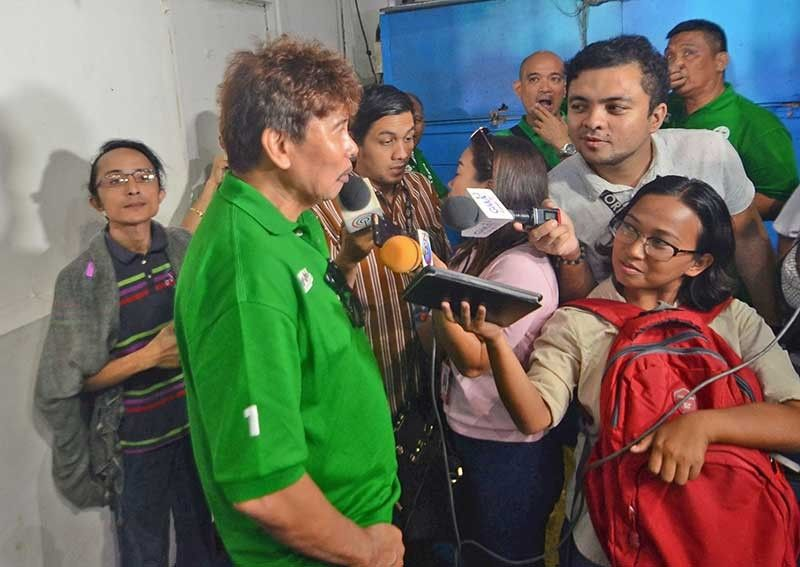 "Colorful personality. Businessman and San Fernando mayoral candidate Ruben Feliciano (second from left) has never been one to mince words when it comes to criticizing his rival in the midterm elections. Earlier this year, a ""kill list"" containing the names of the Reluyas and their allies was posted on social media and attributed to him. Feliciano denied any involvement even though authorities later arrested one of his supporters, Shielbert Michael Alerta Encabo (left), for allegedly posting the list on Facebook. (SunStar Photo/Alan Tangcawan)"