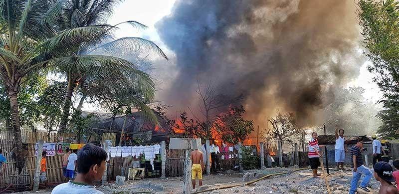 BACOLOD. Fire in Purok Masagana, Barangay 6 destroys 20 houses including that of Sangguniang Kabataan Federation President Ayesha Joy Villaflor. (Contributed photo)