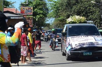 Funeral Convoy. The road to the Cattleya Gardens Memorial Park in Cordova is lined with onlookers hoping to catch a last glimpse of Christine Lee Silawan's casket. (SunStar Photo/Alan Tangcawan)