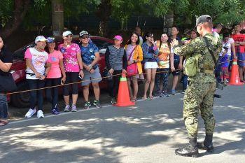 DAVAO. Nahimong photographer niining usa ka grupo ang usa ka sakop sa Task Force Davao atol sa Alveo IronMan 70.3 triathlon, sa Dominggo, Marso 24, sa Lanang, Davao City. (Macky Lim)