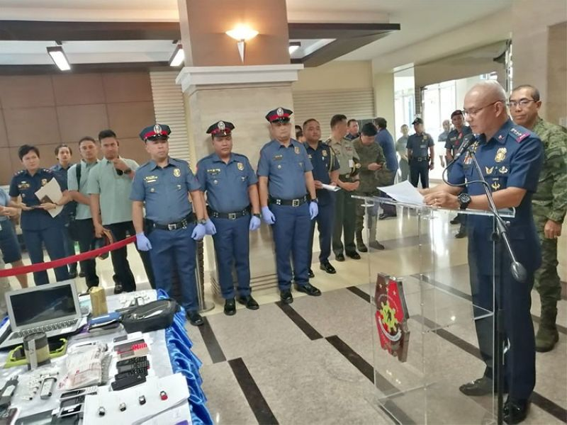 MANILA. Philippine National Police Chief Oscar Albayalde (right) presents the items confiscated from communist consultant Francisco Hernandez in Liliw, Laguna. (Third Anne Peralta-Malonzo)