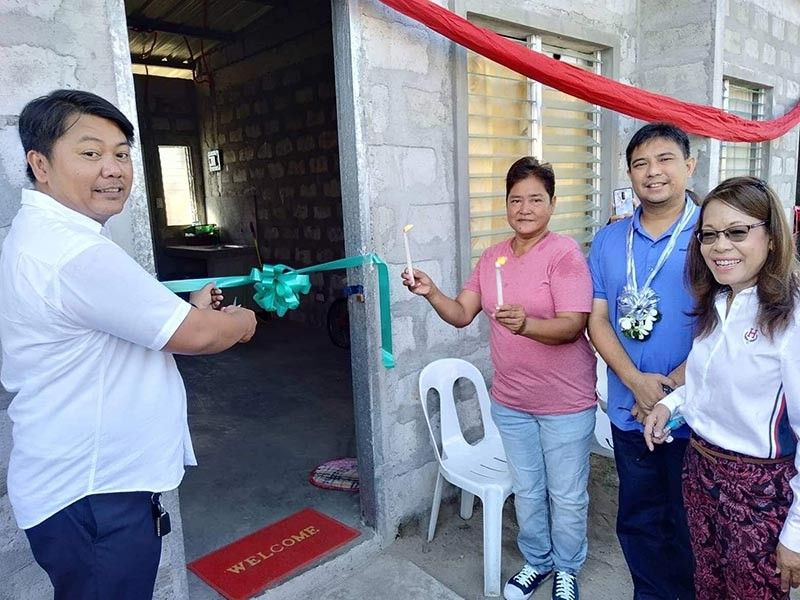 PAMPANGA. Former Sasmuan mayor Catalina Bagasina, returning 2nd District Rep. Mikey Arroyo and SPIDC president Ramon Catacutan led the ribbon cutting and turnover of a new house and lot to a beneficiary. (Contributed Photo)