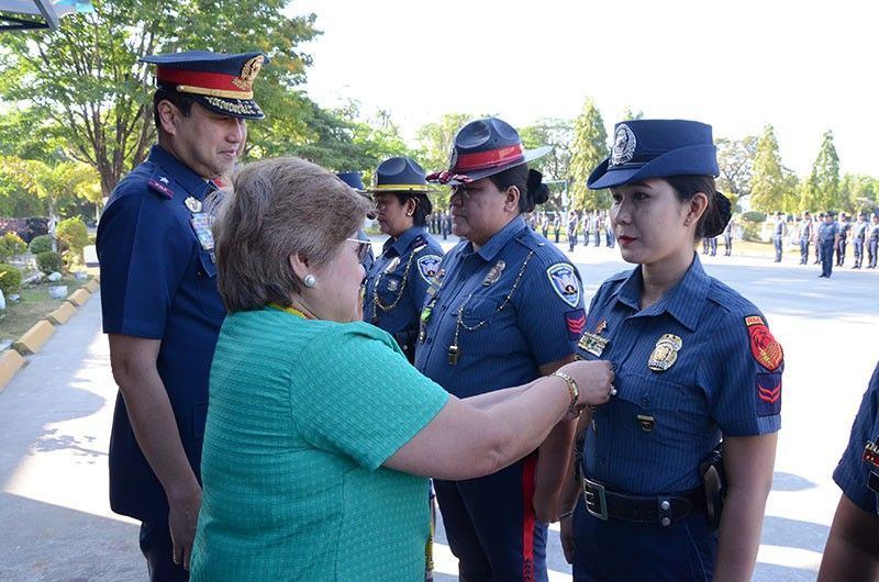 PAMPANGA. Commission on Population and Development Central Luzon director Rosa Fortaleza pins a medal of recognition to a policewoman during the creation of the all women battalion at the PRO-3 parade grounds at Camp Olivas on Monday, March 25, 2019. (PRO-Central Luzon RPIO)