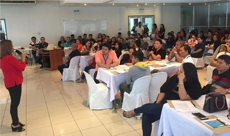 Insuring Talk. Government Service Insurance System Cebu Manager Mercedes VPE Enriquez discusses the Republic Act 656 during the property officers' forum. (Contributed Photo)